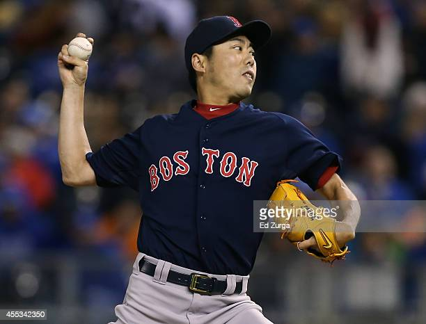 Koji Uehara of the Boston Red Sox throws in the eighth inning against the Kansas City Royals at Kauffman Stadium on September 12 2014 in Kansas City...