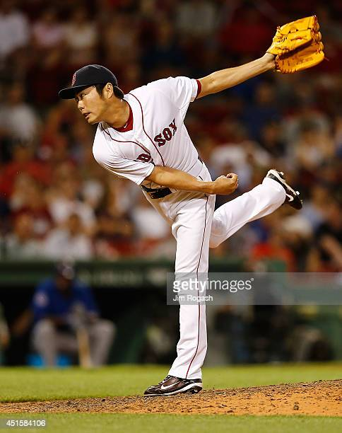 Koji Uehara of the Boston Red Sox throws in the ninth inning against the Chicago Cubs at Fenway Park on July 1 2014 in Boston Massachusetts