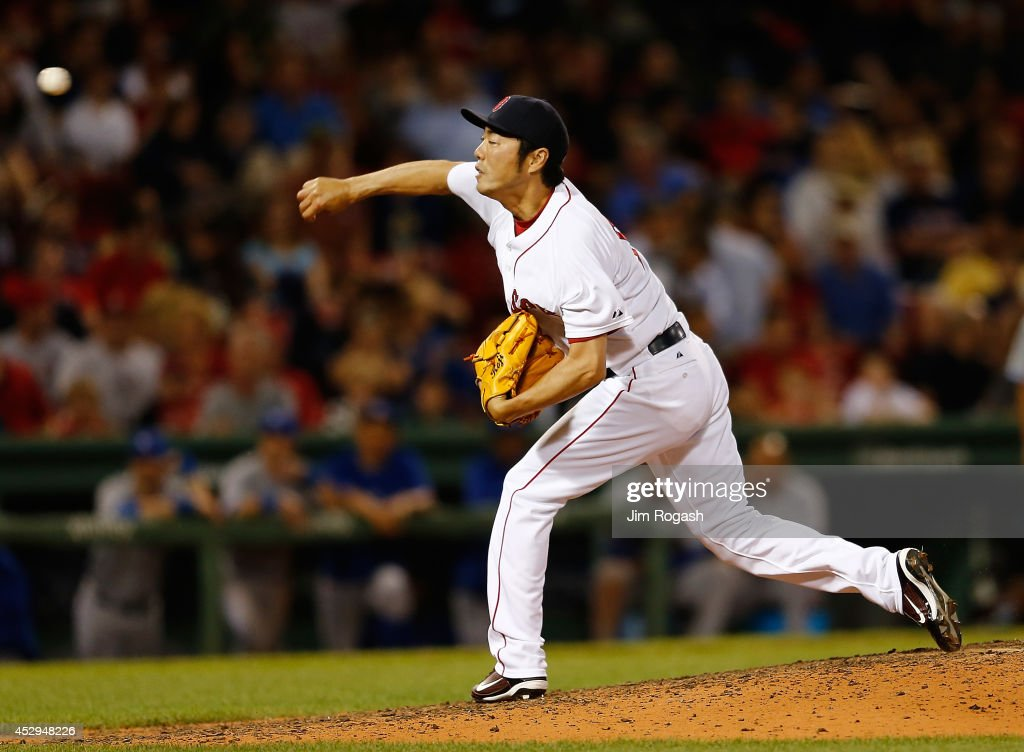 Koji Uehara #19 of the Boston Red Sox throws in the ninth inning against the Toronto Blue Jays at Fenway Park on July 30, 2014 in Boston, Massachusetts.