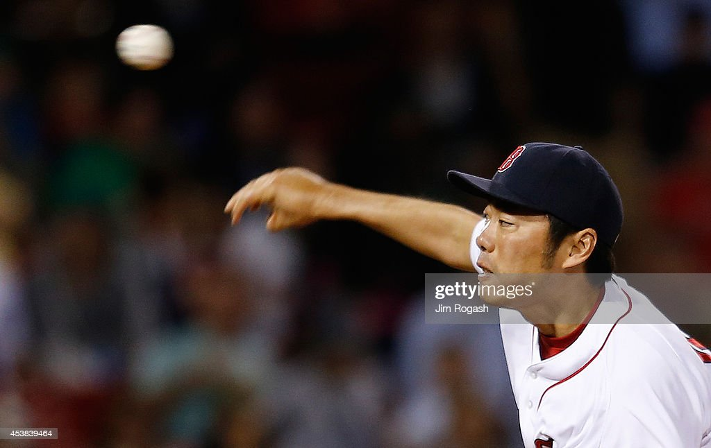 Koji Uehara #19 of the Boston Red Sox throws in the ninth inning against the Los Angeles Angels of Anaheim at Fenway Park on August 19, 2014 in Boston, Massachusetts.