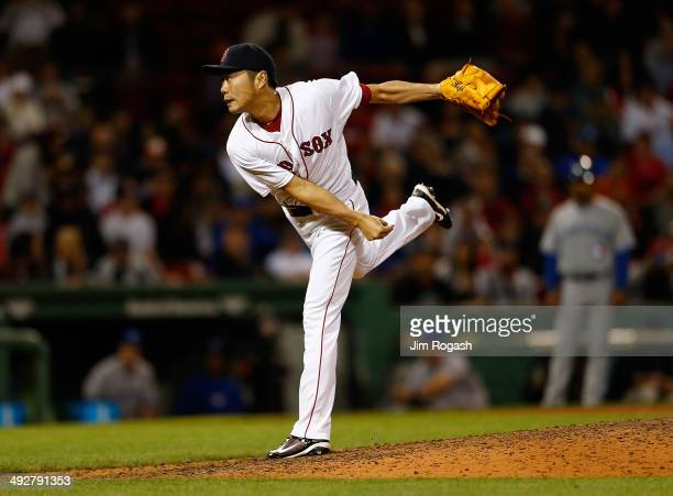 Koji Uehara of the Boston Red Sox throws in the ninth inning against Toronto Blue Jays at Fenway Park on May 21 2014 in Boston Massachusetts