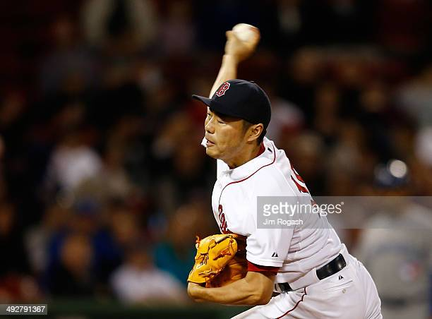 Koji Uehara of the Boston Red Sox throws in the ninth inning against Toronto Blue Jays at Fenway Park on May 21, 2014 in Boston, Massachusetts.