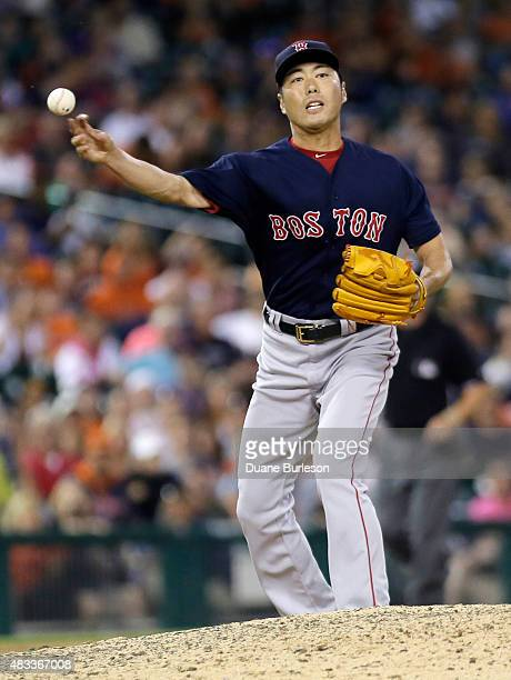 Koji Uehara of the Boston Red Sox throws out Ian Kinsler of the Detroit Tigers at first base for the final out after taking a line drive to the right...