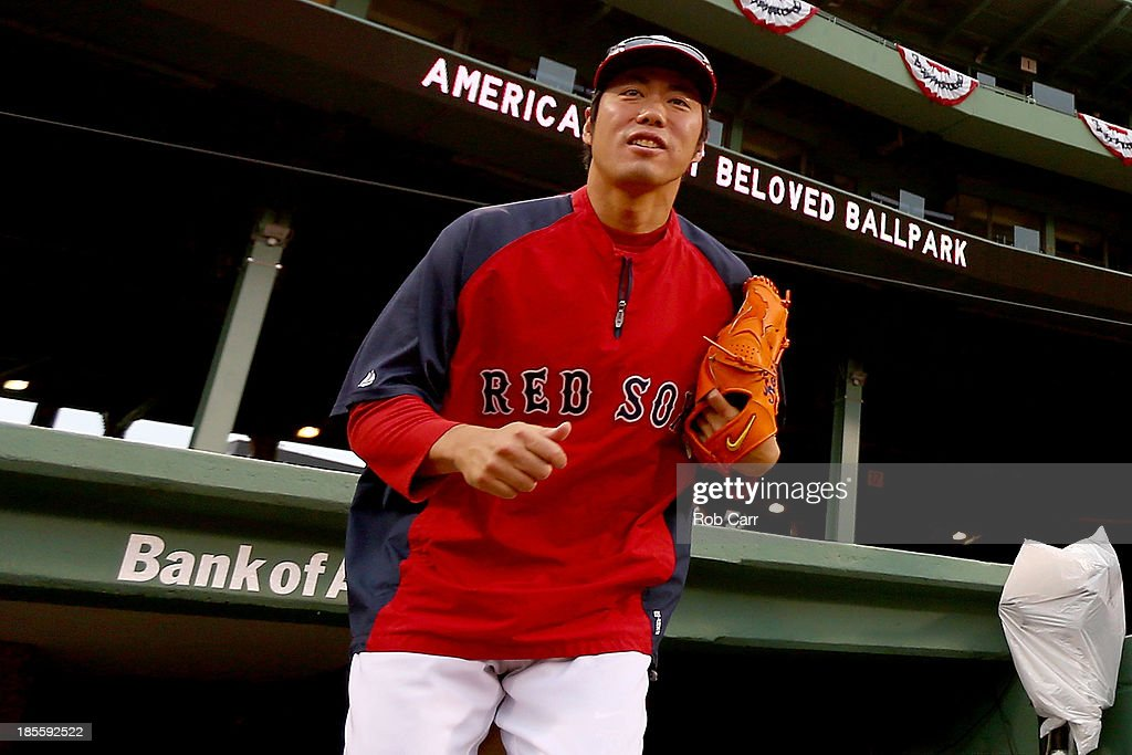 Koji Uehara #19 of the Boston Red Sox walks out of the dugout during team workouts in the 2013 World Series Media Day at Fenway Park on October 22, 2013 in Boston, Massachusetts. The Red Sox host the Cardinals in Game 1 on October 23, 2013.