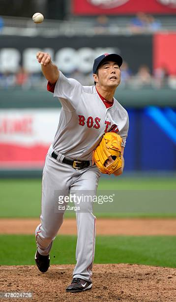 Koji Uehara of the Boston Red Sox warms up as he prepares to pitch against the Kansas City Royals in the ninth inning at Kauffman Stadium on June 21...