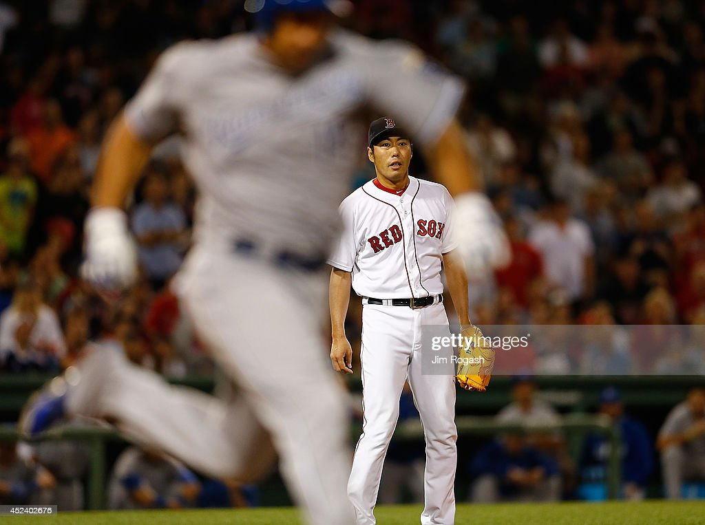 Koji Uehara #19 of the Boston Red Sox watches the final out of a game against the Kansas City Royals to give the Red Sox a 2-1 win at Fenway Park on July 19, 2014 in Boston, Massachusetts.