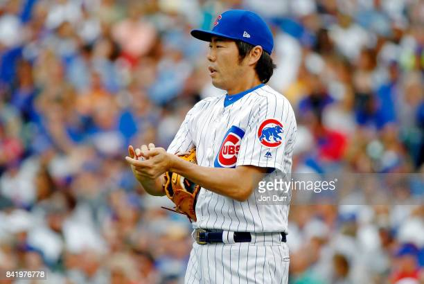 Koji Uehara of the Chicago Cubs between pitches during the seventh inning against the Atlanta Braves at Wrigley Field on September 2 2017 in Chicago...