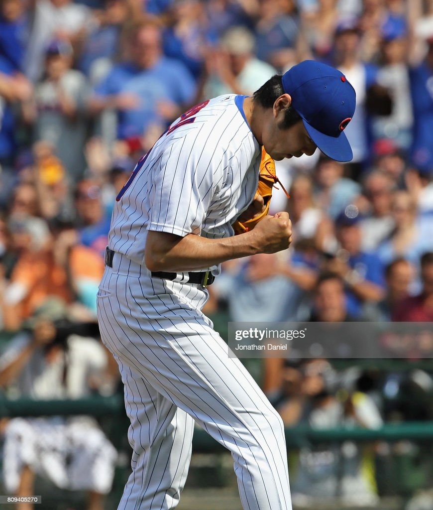 Koji Uehara #19 of the Chicago Cubs celebrates after getting the final out of the 8th inning against the Tampa Bay Rays at Wrigley Field on July 5, 2017 in Chicago, Illinois.