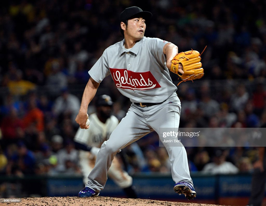 Koji Uehara #19 of the Chicago Cubs delivers a pitch in the eighth inning during the game against the Pittsburgh Pirates at PNC Park on June 16, 2017 in Pittsburgh, Pennsylvania. In honor of African American Heritage Night, both teams are wearing throwback uniforms from the Negro League.