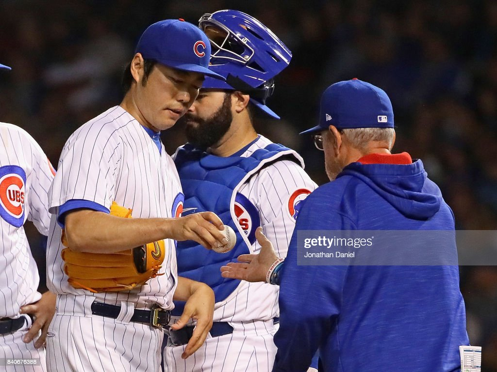 Koji Uehara #19 of the Chicago Cubs is taken out of the game in the 7th inning by manager Joe Maddon #70 against the Pittsburgh Pirates at Wrigley Field on August 29, 2017 in Chicago, Illinois.