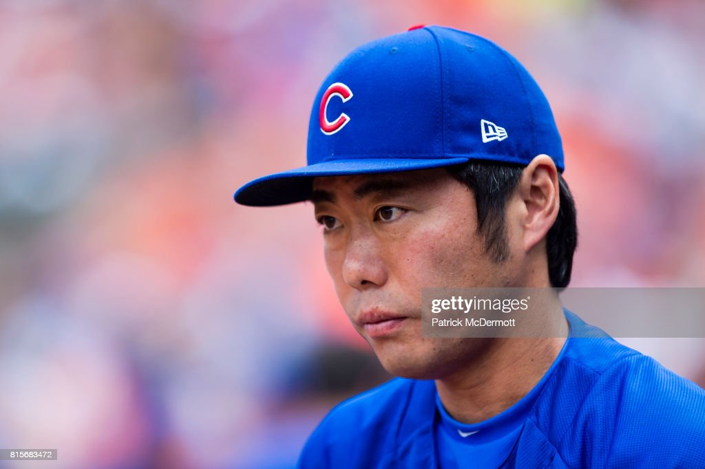 Koji Uehara #19 of the Chicago Cubs looks on from the dugout in the fourth inning during a game against the Baltimore Orioles at Oriole Park at Camden Yards on July 16, 2017 in Baltimore, Maryland.
