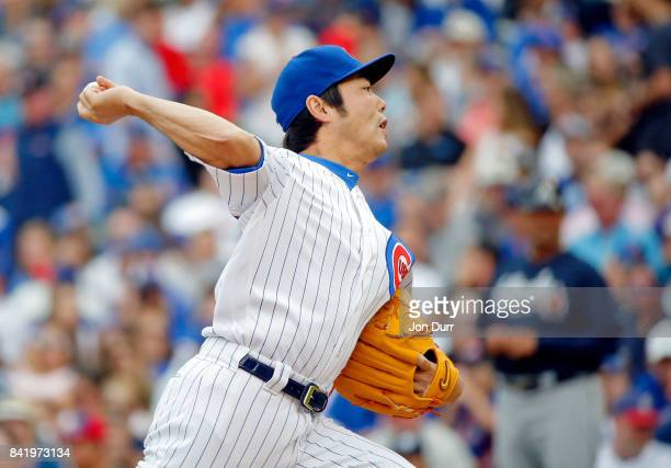 Koji Uehara of the Chicago Cubs pitches against the Atlanta Braves during the seventh inning at Wrigley Field on September 2 2017 in Chicago Illinois