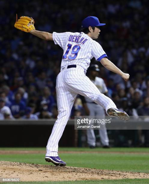 Koji Uehara of the Chicago Cubs pitches in the 7th inning against the Pittsburgh Pirates at Wrigley Field on August 29 2017 in Chicago Illinois