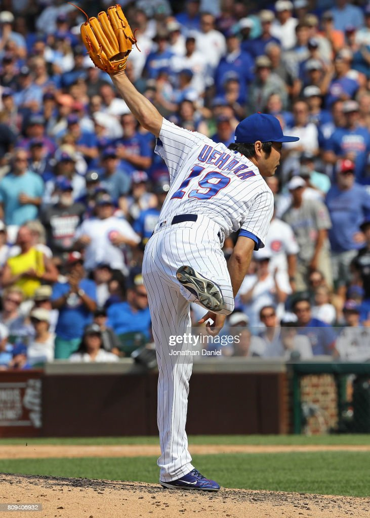 Koji Uehara #19 of the Chicago Cubs pitches in the 8th inning against the Tampa Bay Rays at Wrigley Field on July 5, 2017 in Chicago, Illinois.