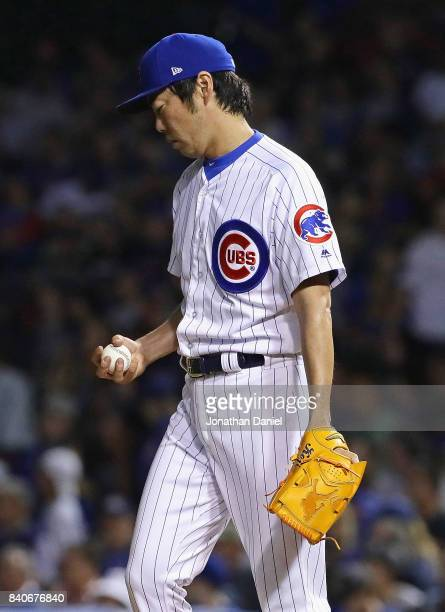 Koji Uehara of the Chicago Cubs reacts after giving up a single in the 7th inning against the Pittsburgh Pirates at Wrigley Field on August 29 2017...