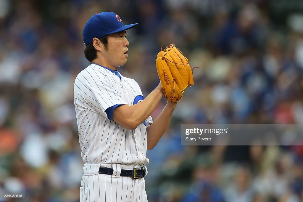 Koji Uehara #19 of the Chicago Cubs throws a pitch during the tenth inning of a game against the Toronto Blue Jays at Wrigley Field on August 20, 2017 in Chicago, Illinois.