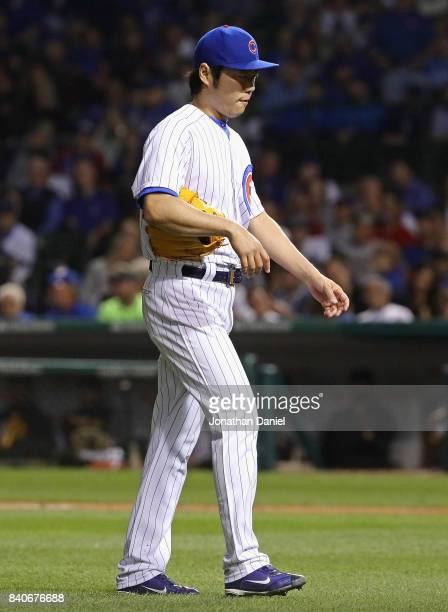 Koji Uehara of the Chicago Cubs walks to the dugout after being taken out of the game in the 7th inning against the Pittsburgh Pirates at Wrigley...