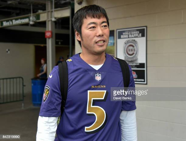 Koji Uehara of the Chicago Cubs wears a football jersey as the Cubs leave on their road trip September 3 2017 at Wrigley Field in Chicago Illinois