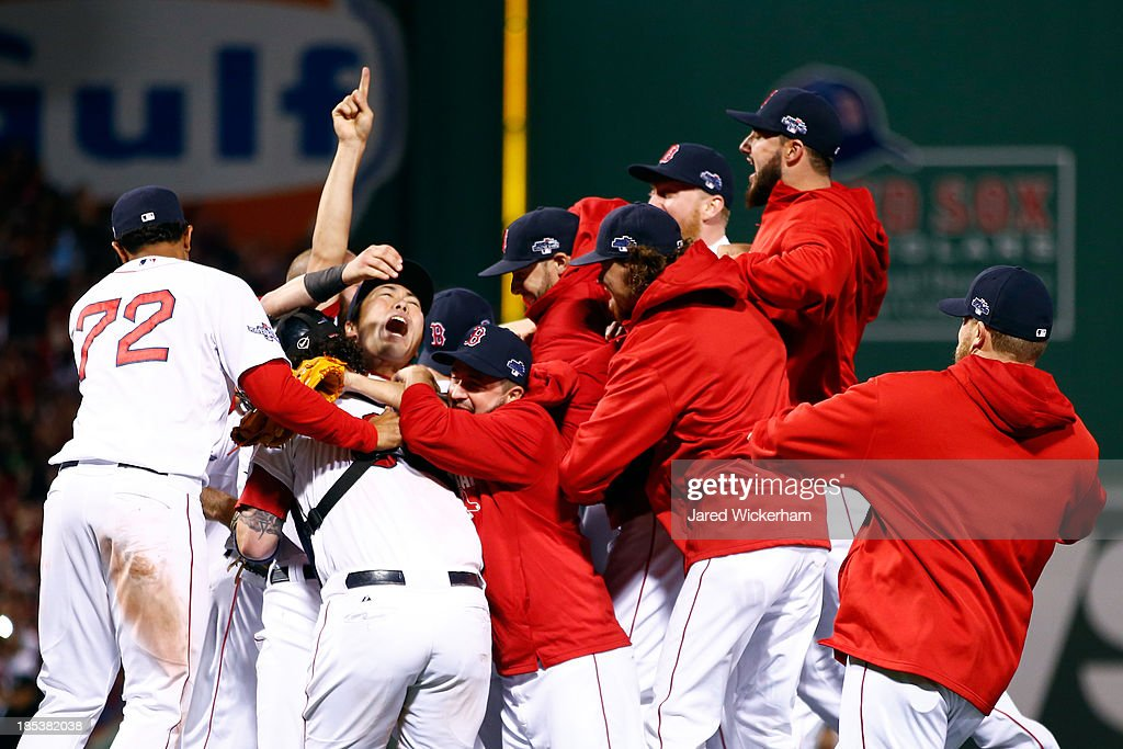 Koji Uehara #19of the Boston Red Sox celebrates with his teammates after defeating the Detroit Tigers in Game Six of the American League Championship Series at Fenway Park on October 19, 2013 in Boston, Massachusetts. The Red Sox defeated the Tigers 5-2 to clinch the ALCS in six games.
