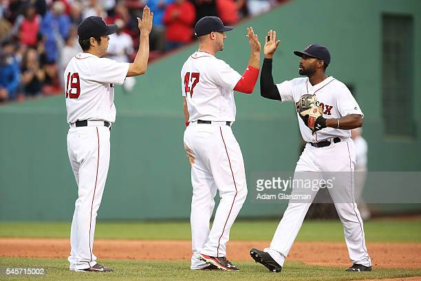 Koji Uehara Travis Shaw and Jackie Bradley Jr #25 of the Boston Red Sox high five after their victory over the Tampa Bay Rays at Fenway Park on July...
