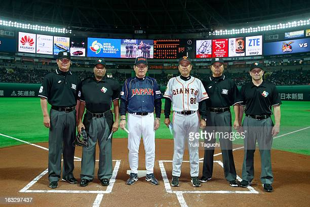 Koji Yamamoto manager of Team Japan and Tatsunori Hara manager of the Yomiuri Giants pose for a photo with the umpiring crew before the 2013 World...