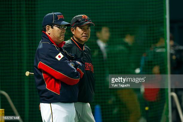 Koji Yamamoto manager of Team Japan talks with Tatsunori Hara manager of the Yomiuri Giants before the 2013 World Baseball Classic exhibition game...