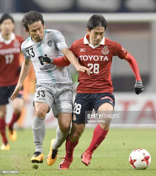 Koji Yamase of Avispa Fukuoka and Keiji Tamada of Nagoya Grampus fight for the ball in the second half of a 00 draw in the JLeague second division...