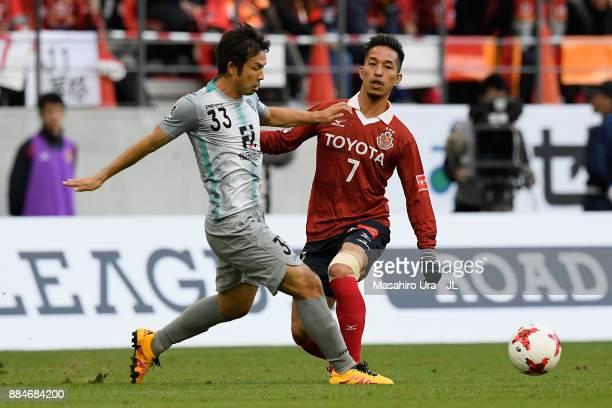 Koji Yamase of Avispa Fukuoka and Taishi Taguchi of Nagoya Grampus compete for the ball during the J.League J1 Promotion Play-Off Final between...