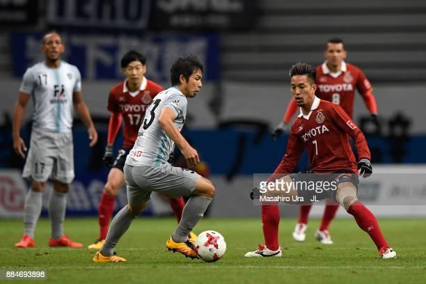 Koji Yamase of Avispa Fukuoka takes on Taishi Taguchi of Nagoya Grampus during the J.League J1 Promotion Play-Off Final between Nagoya Grampus and...