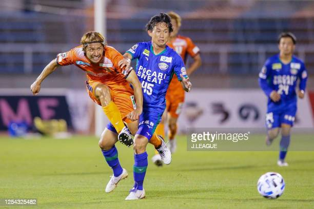 Koji Yamase of Ehime FC and Koki Sugimori of Tokushima Vortis during the J.League Meiji Yasuda J2 match between Ehime FC and Tokushima Vortis at the...