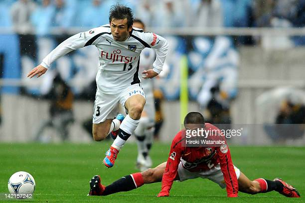 Koji Yamase of Kawasaki Frontale and Keisuke Tsuboi of Urawa Red Diamonds compete for the ball during the JLeague match between Urawa Red Diamonds...