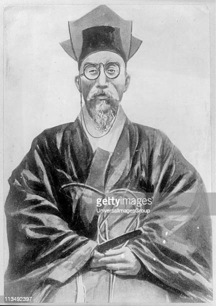 Kojong Emperor of Korea Threequarter length portrait of Emperor wearing spectacles seated looking forwards