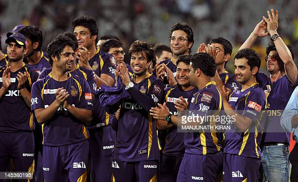 Kokatta Knight Riders coowner and Bollywood actor Shah Rukh Khan and cricketers celebrate after winning the DLF IPL Twenty20 Champions Trophy...