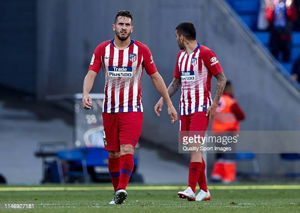 Koke and Angel Correa of Club Atletico de Madrid reacts at the end of the match the La Liga match between RCD Espanyol and Club Atletico de Madrid at...