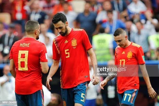 Koke and Sergio Busquets of Spain are seen during the 2018 FIFA World Cup Russia Round of 16 match between Spain and Russia at the Luzhniki Stadium...