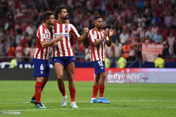 Koke Diego Costa and Renan Lodi of Atletico Madrid celebrate victory at fulltime after the Liga match between Club Atletico de Madrid and SD Eibar...