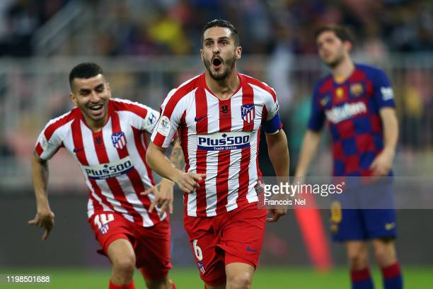Koke of Athletico Madrid celebrates scoring the first goal during the Supercopa de Espana SemiFinal match between FC Barcelona and Club Atletico de...