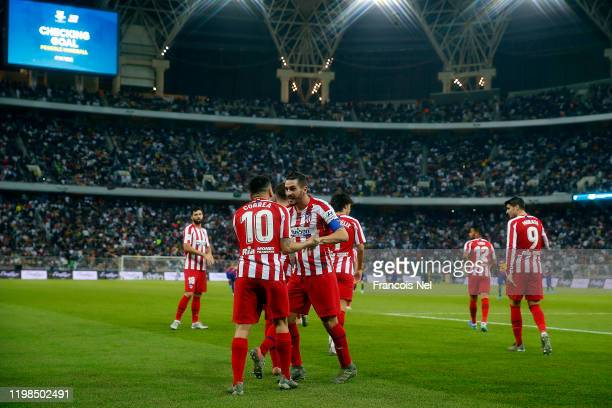 Koke of Athletico Madrid celebrates scoring with team mates during the Supercopa de Espana SemiFinal match between FC Barcelona and Club Atletico de...