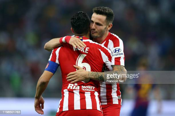 Koke of Athletico Madrid celebrates with Saul Niguez after scoring the first goal during the Supercopa de Espana SemiFinal match between FC Barcelona...
