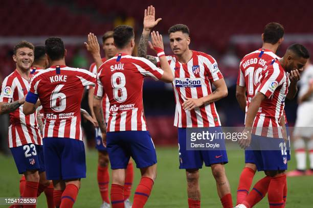 Koke of Atletico celebrates with Kieran Trippier after scoring his side's third goal during the Liga match between Club Atletico de Madrid and RCD...
