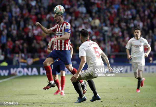 Koke of Atletico de Madrid and Lucas Ocampos of Sevilla FC battle for the ball during the La Liga match between Club Atletico de Madrid and Sevilla...