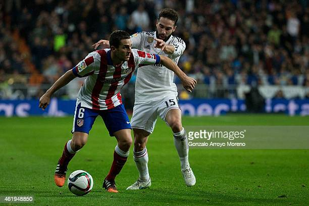Koke of Atletico de Madrid competes for the ball with Daniel Carvajal of Real Madrid CF during the Copa del Rey Round of 16 second leg match between...