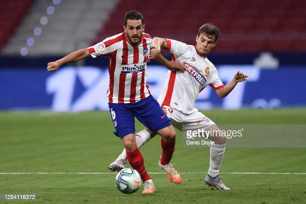 Koke of Atletico de Madrid is challenged by Aleix Febas of Mallorca during the Liga match between Club Atletico de Madrid and RCD Mallorca at Wanda...