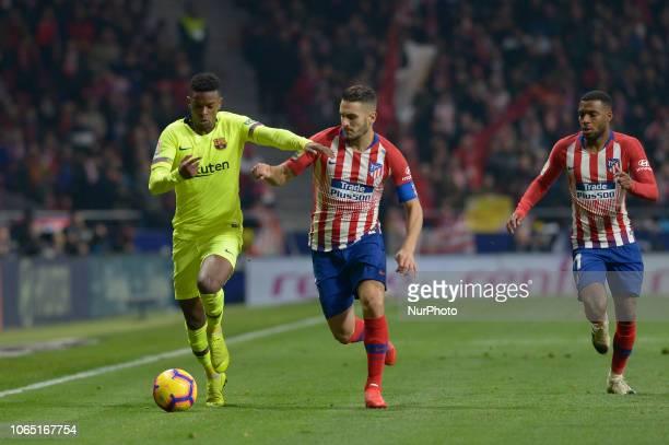 Koke of Atletico de Madrid of Atletico de Madrid fight the ball with Semedo Barcelona during a match between Atletico de Madrid vs Barcelona for...