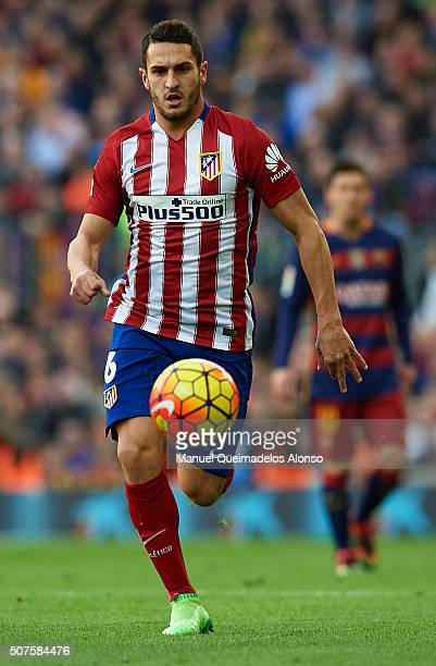 Koke of Atletico de Madrid runs with the ball during the La Liga match between FC Barcelona and Atletico de Madrid at Camp Nou on January 30 2016 in...