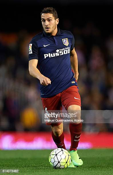 Koke of Atletico de Madrid runs with the ball during the La Liga match between Valencia CF and Atletico de Madrid at Estadi de Mestalla on March 06...