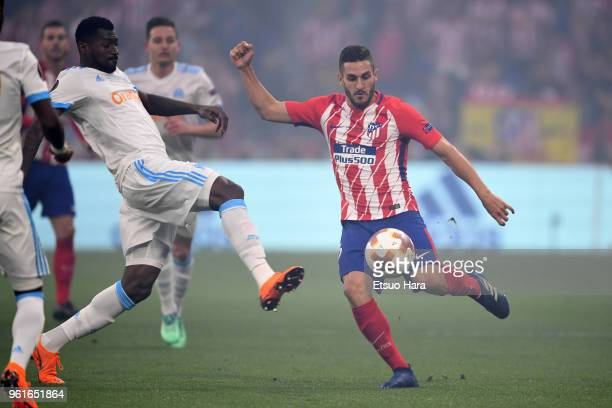 Koke of Atletico Madrid and AndreFrank Zambo Anguissa of Olympique Marseille compete for the ball during the UEFA Europa League Final between...