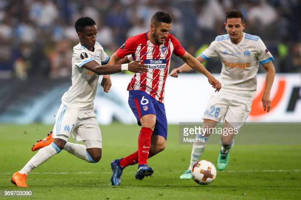 Koke of Atletico Madrid and Bouna Sarr of Marseille battle for the ball during the UEFA Europa League Final between Olympique de Marseille and Club...