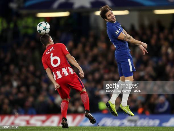 Koke of Atletico Madrid and Cesc Fabregas of Chelsea during the UEFA Champions League group C match between Chelsea FC and Atletico Madrid at...