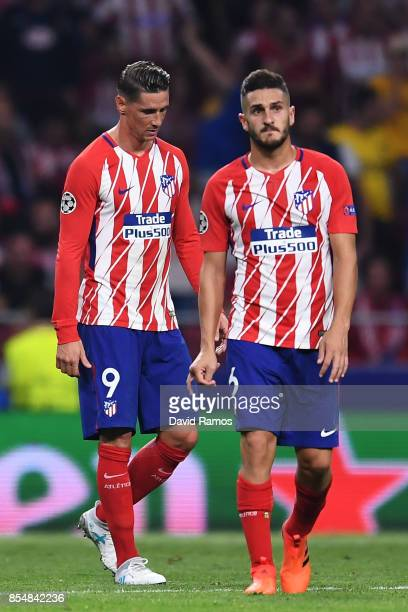 Koke of Atletico Madrid and Fernando Torres of Atletico Madrid look dejected following defeat during the UEFA Champions League group C match between...